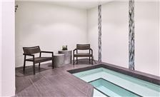 After a treatment at the spa, relax and soak in the spa's whirlpool.